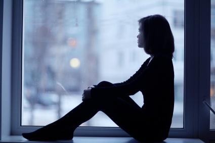 girl silhouette window